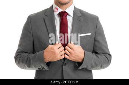 Jeune homme d'affaires avec imprimé lèvres sur col chemise sur fond blanc Banque D'Images