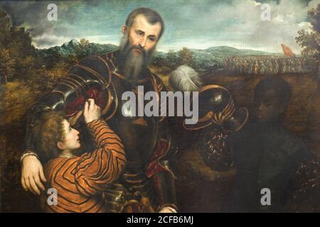 Portrait d'un homme en armure avec deux pages Banque D'Images