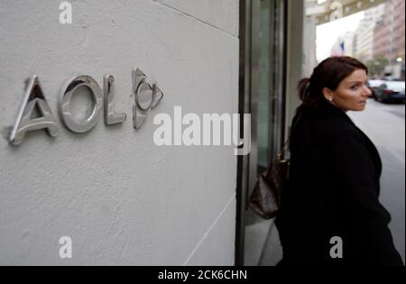 A woman walks out of AOL offices in New York, November 19, 2009. AOL plans to cut one-third of its workforce, or about 2,500 jobs, in an effort to trim some $300 million in annual costs as part of the Internet company's planned spin-off from Time Warner Inc. The struggling Web pioneer, which is now focused primarily on advertising-supported content, said on Thursday that it would start with a volunteer buyout program and move on to involuntary layoffs if enough workers do not step up.   REUTERS/Shannon Stapleton  (UNITED STATES BUSINESS SCI TECH EMPLOYMENT) - Stock Photo