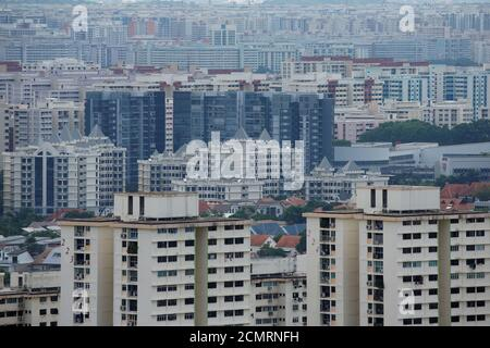 A view of private residential apartments and public housing estates in Singapore June 13, 2016. REUTERS/Edgar Su - Stock Photo