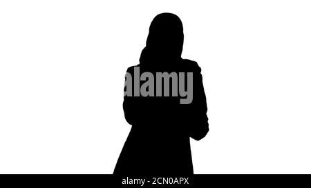 Silhouette arabe femme d'affaires portant le hijab parlant sur le p