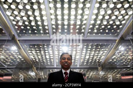 Infosys Chief Executive S.D. Shibulal poses for a picture after an interview with Reuters near his office inside their campus in the Electronic City area in Bangalore September 4, 2012. Infosys Ltd, the company that symbolised India's rise as an outsourcing powerhouse but has struggled this year, will have to wait longer than expected for returns from a remodelled strategy, according to Shibulal.      To match Interview INDIA-INFOSYS/      REUTERS/Vivek Prakash (INDIA - Tags: BUSINESS HEADSHOT SCIENCE TECHNOLOGY) - Stock Photo