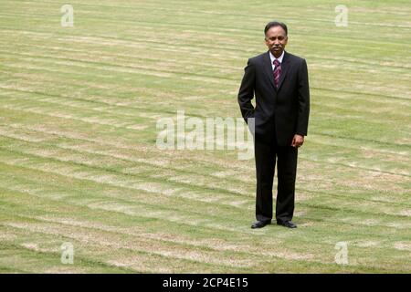 Infosys Chief Executive S.D. Shibulal poses for a picture after an interview with Reuters on a lawn inside their campus in the Electronic City area in Bangalore September 4, 2012. Infosys Ltd, the company that symbolised India's rise as an outsourcing powerhouse but has struggled this year, will have to wait longer than expected for returns from a remodelled strategy, according to S.D. Shibulal, the company's chief executive officer. Picture taken September 4, 2012.       To match Interview INDIA-INFOSYS/      REUTERS/Vivek Prakash (INDIA - Tags: SCIENCE TECHNOLOGY BUSINESS) - Stock Photo