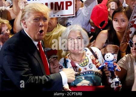 Republican U.S. Presidential candidate Donald Trump greets people in the crowd at a campaign rally in Phoenix, Arizona, June 18, 2016. REUTERS/Nancy Wiechec - Stock Photo