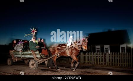 Performers ride a horse-drawn cart as they sing Christmas carols, locally known as 'Kolyadki', in the village of Gantsevichi, about 180 km (112 miles) southeast of Minsk, January 13, 2012. Many Orthodox Belarussians mark New Year according to the Julian calendar on January 13. REUTERS/Vasily Fedosenko(BELARUS - Tags: SOCIETY ANIMALS)