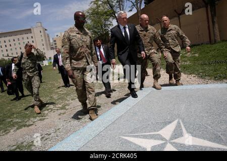 U.S. Defense Secretary James Mattis (3rd R) is greeted by U.S. Army Command Sergeant Major David Clark (L) and General Christopher Haas (2nd R) as he arrives at Resolute Support headquarters in Kabul, Afghanistan April 24, 2017. REUTERS/Jonathan Ernst