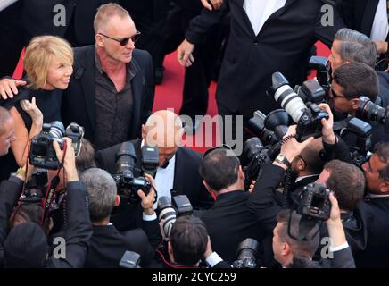 Singer Sting and his wife British actress and producer Trudie Styler arrive on the red carpet for the film 'Mud', in competition at the 65th Cannes Film Festival, May 26, 2012.            REUTERS/Loic Venance/Pool (FRANCE  - Tags: ENTERTAINMENT) - Stock Photo