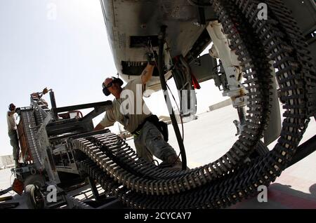 U.S. Air Force ground staff members load ammunition to an A-10 Thunderbolt II fighter-jet from the 81st Expeditionary Fighter Squadron before takeoff for a mission over Kandahar province, Kandahar Air Field, September 2, 2010.   REUTERS/Oleg Popov   (AFGHANISTAN - Tags: CONFLICT MILITARY TRANSPORT IMAGES OF THE DAY)