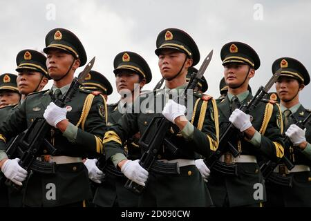 Chinese People's Liberation Army (PLA) soldiers march during an open day at the Ngong Shuen Chau Naval Base on Hong Kong's Stonecutters Island July 28, 2012. The naval base was open to the public on Saturday, four days ahead of the PLA Army Day on August 1. REUTERS/Tyrone Siu (CHINA - Tags: POLITICS MILITARY)