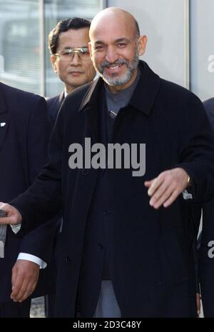 Afghanistan's interim leader Hamid Karzai arrives at Tokyo's Haneda airport January 20, 2002. Karzai flew in to Japan to make his global debut at an international conference on the reconstruction of Afghanistan.