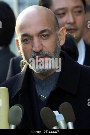 Afghanistan's interim leader Hamid Karzai speaks to reporters on arrival at Tokyo's Haneda airport January 20, 2002. Karzai flew in to Japan to make his global debut at an international conference on the reconstruction of Afghanistan.