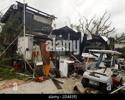 A destroyed home is seen in Boca Grande, Florida after Hurricane Charley passed south of the Island August 13, 2004. Hurricane Charley slammed Florida's west coast with winds of 145 mph (233 kph) on Friday, striking farther south than expected and ripping apart mobile homes, snapping cement columns and shearing off roofs in unprepared seaside towns.