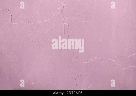 Le fond de peinture séchée sur la surface métallique. Texture rose mur sale, espace de copie