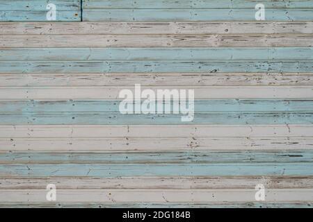 bandes peintes en bleu pastel et blanc sur des panneaux en bois. Arrière-plan.