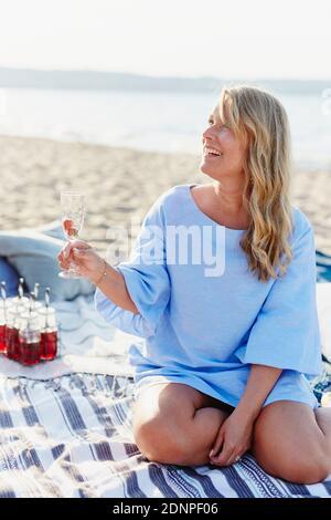 Woman having picnic on beach