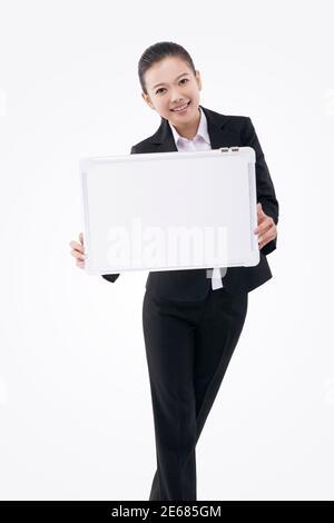 Femme d'affaires avec tableau blanc photo de haute qualité