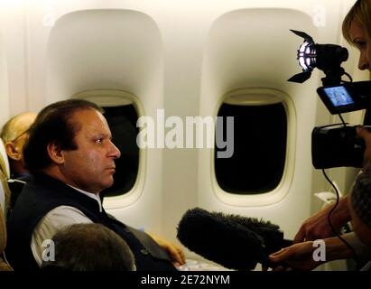Former Pakistani prime minister Nawaz Sharif speaks to the media onboard a Pakistani aircraft on his return from London, September 10, 2007. Sharif was arrested and deported to Saudi Arabia on Monday within hours of arriving home from exile, vowing to end the rule of President Pervez Musharraf. Sharif's return from seven years in exile, most recently in London, was always going to spark a confrontation with General Musharraf, the army chief who ousted Sharif in 1999 and cast him into exile in Saudi Arabia the following year.   REUTERS/Petr Josek  (BRITAIN)