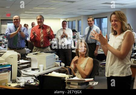 The newsroom greets reporter Alexandra Berzon upon learning of the Las Vegas Sun's win of the Pulitzer Prize for public service for exposing a high death rate among construction workers on the Las Vegas Strip, at the Las Vegas Sun offices in Henderson, Nevada, April 20, 2009. REUTERS/Tiffany Brown/Las Vegas Sun (UNITED STATES)