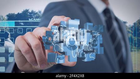 Composition de l'homme d'affaires tenant un réseau d'icônes numériques