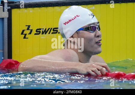 Qingdao, Chine. 5 mai 2021. Il Junyi, de Zhejiang, réagit après la finale libre de 100m des hommes aux Championnats nationaux de natation chinois 2021 à Qingdao, en Chine orientale, le 5 mai 2021. Credit: Xu Chang/Xinhua/Alay Live News
