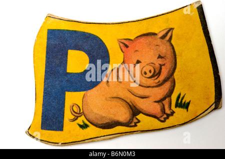 Lettre alphabet vintage morceau de puzzle pour les enfants avec la lettre L et la photo de sucettes imprimées sur Banque D'Images