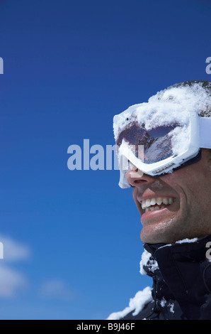 Man, le visage recouvert de neige Banque D'Images