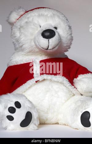 Portrait de l'ours en peluche habillé en costume père noël Banque D'Images