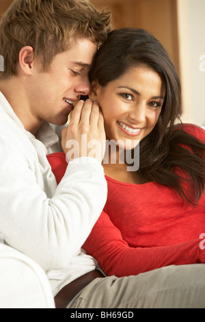 Young Couple Sitting on Sofa Banque D'Images