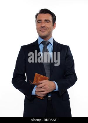 Un homme de race blanche de l'homme professeur enseignant livre holding smiling at camera studio isolé sur fond Banque D'Images