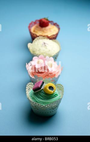 Quatre petits gâteaux Banque D'Images