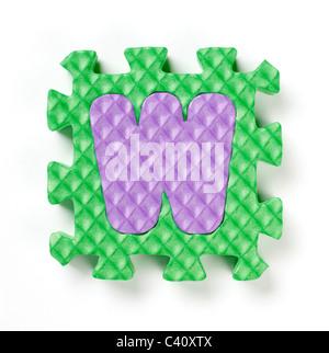Pièce de puzzle alphabet W Banque D'Images