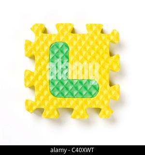 Pièce de puzzle L'alphabet Banque D'Images