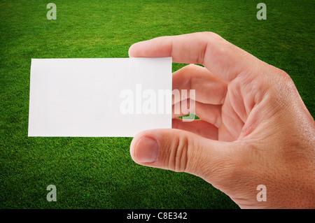 Main tenant une carte vide plus grunge background Banque D'Images