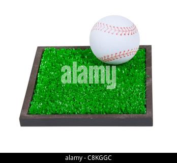 Le base-ball sur un carré d'herbe verte est le temps passé national pour les après-midi d'été - chemin inclus Banque D'Images
