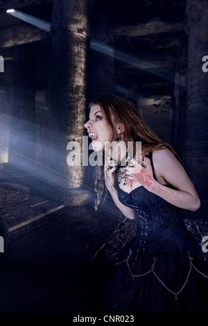 En raison de la souffrance Vampire contact avec lumière Banque D'Images