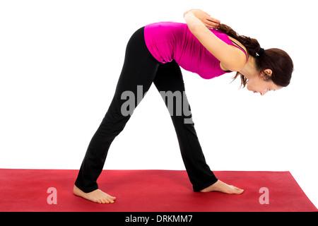 Young woman doing Stretch côté intense dans le Yoga Pose Banque D'Images