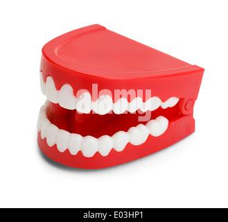 Vent en plastique rouge jusqu'Chatttering les dents. Isolé sur fond blanc. Banque D'Images
