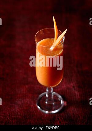 Melon,carotte et jus de citron Banque D'Images