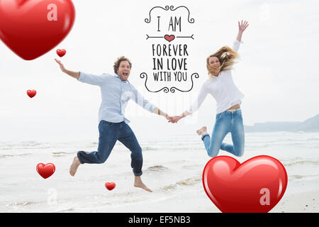 Composite image of cheerful couple holding hands and jumping at beach Banque D'Images