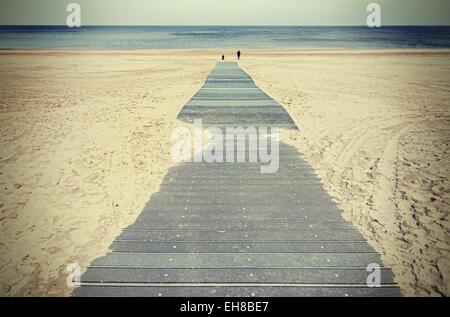 Retro photo aux couleurs d'une promenade sur la plage. Banque D'Images