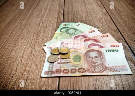Billet thaïlandais et des pièces le tableau Banque D'Images