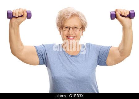 Young woman exercising with dumbbells pourpre deux isolé sur fond blanc Banque D'Images
