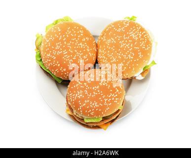 Les burgers sur une plaque sur un fond whote Banque D'Images