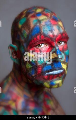 Portrait grave villain, bariolé, l'art avec Tilt Shift et effet de flou. Banque D'Images