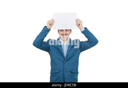 Smiling businessman ou couvrant la moitié de l'enseignant face à la tenue d'un livre blanc au-dessus de sa tête. Banque D'Images