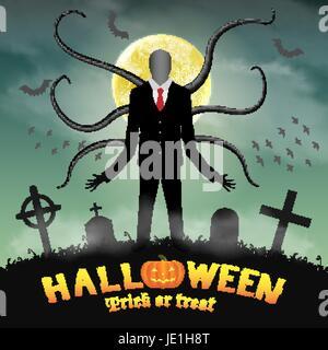 Un grand homme mince d'halloween dans un cimetière de nuit. Banque D'Images