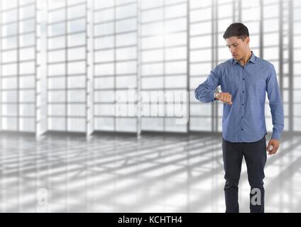 Digital composite de Businessman checking de temps à regarder avec de grandes fenêtres Banque D'Images