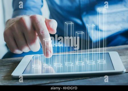 L'analyse commerciale et financière, technologie concept graphique 3D à partir de l'écran de l'ordinateur tablette Banque D'Images