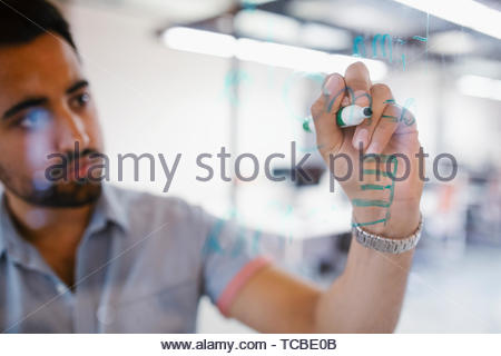 L'accent creative businessman sitting in office Banque D'Images