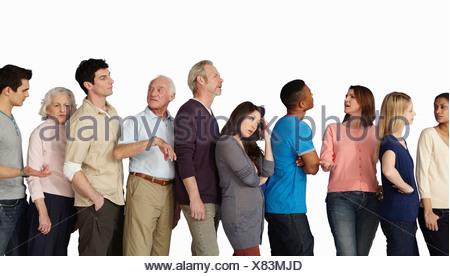 Les gens dans une file d'attente, impatiente Banque D'Images